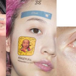 Girl having tattoo at face