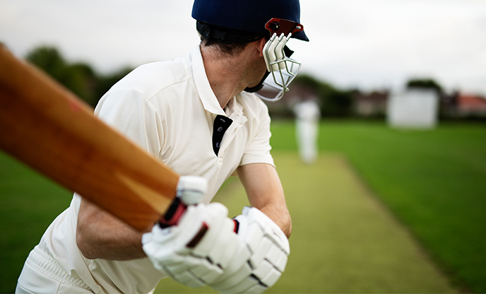 We're Hiring Log in Register Cricketer on the field in action