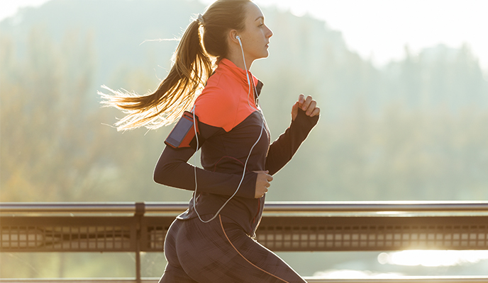 Healthy woman running with blurred background