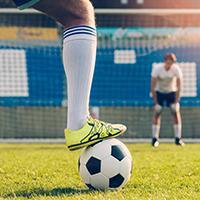 Crop man preparing to shoot goal