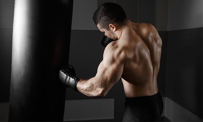 Muscular man practicing boxing