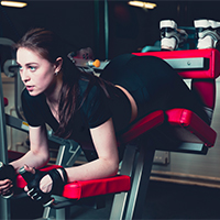 sporty-woman-doing-fitness-exercise-gym