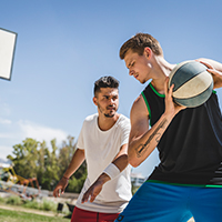 two-male-player-playing-with-basketball