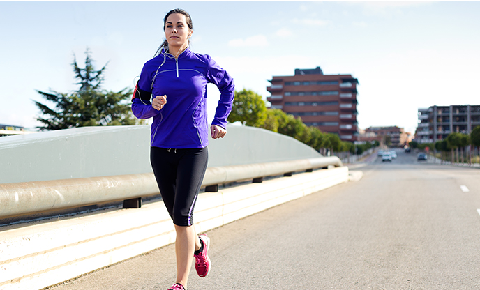 pretty-young-woman-running-city