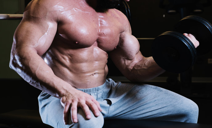 bare-chested-man-lifting-dumbbell