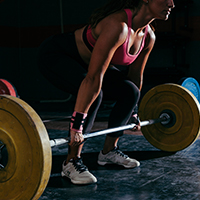 fitness-concept-with-woman-working-out-with-barbell