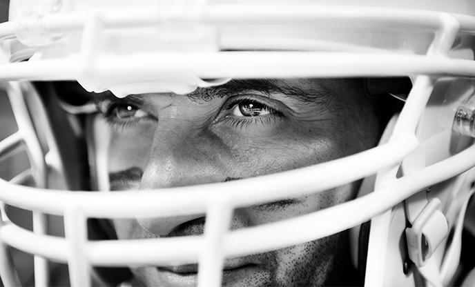 man-wearing-american-football-helmet
