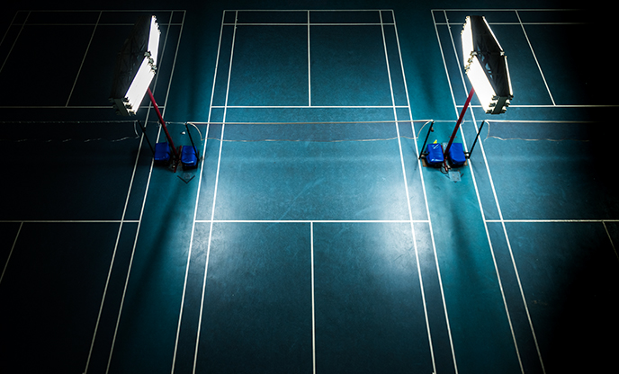 indoor-badminton-court-with-bright-white-lights