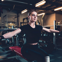 fit-young-woman-doing-exercise-with-dumbbell-fitness-center
