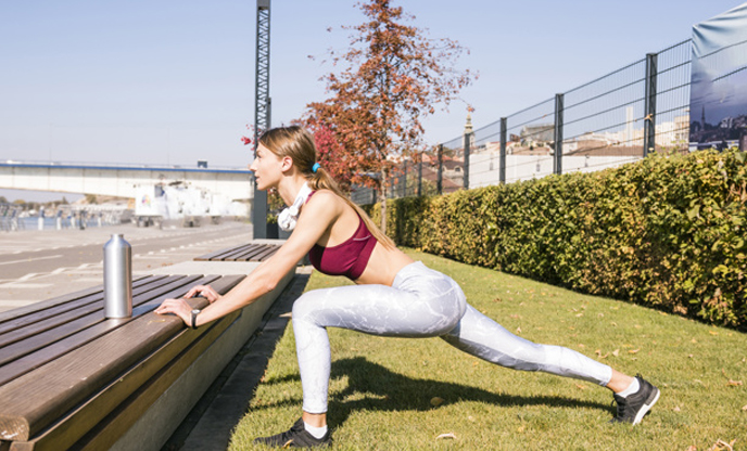 /young-woman-sportswear-stretching-her-leg-outdoor-5-minutes-workout