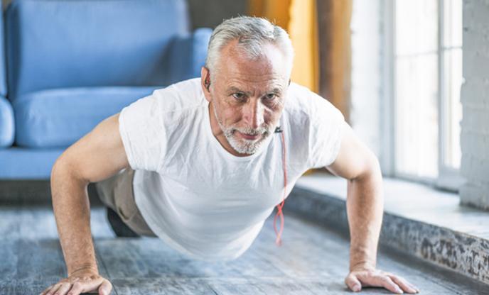 /senior-man-doing-push-up-home