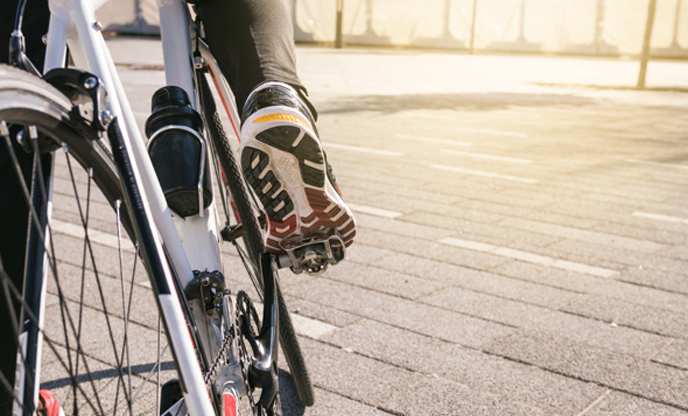 male-cyclist-s-foot-bicycle-pedal-riding-bike-outdoors