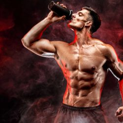Bodybuilder drinking protein in training